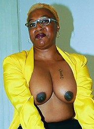 Jenny is a mature black woman who likes to get freaky. Cum climb up in bed with her to see her flash those sexy boobies and big round booty, and every